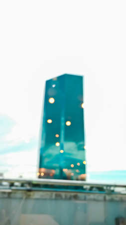 Blurred background of Modern mirror building with light bokeh reflect Imagens