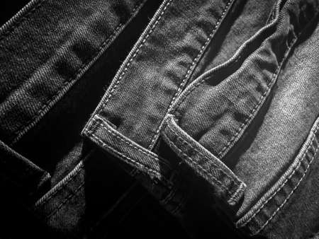 Pile of denim jeans as abstract background - Black and White