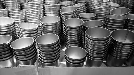 Pile of metal cups background - black and White