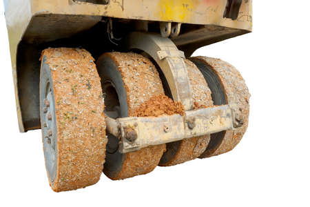 Close-up of compactor wheels isolated on white background