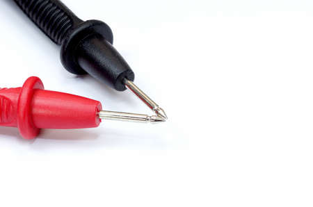 Close-up of multimeter probes on white background - anode and cathode Stock Photo