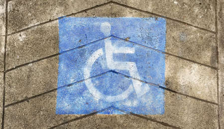 Disabled sign on grunge cement floor Stock Photo
