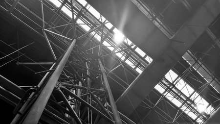 Metal structure with shining lights as industrial background - Black and White Stock Photo