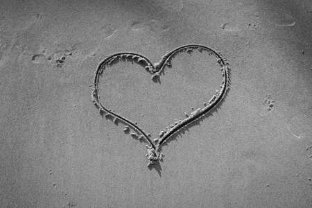 Heart drawn in the sand on Beach background - Black and White