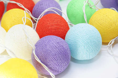 Colorful cotton ball lights used to decorate in Christmas festival for background usage