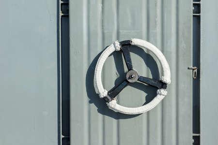 Metal door on the battleship as background