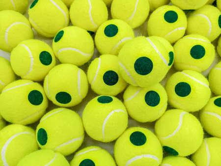 Pile of training tennis balls for sport background