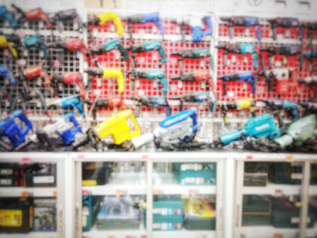 Blurry industrial tools and electric drill in hardware shop as abstract background Stock fotó