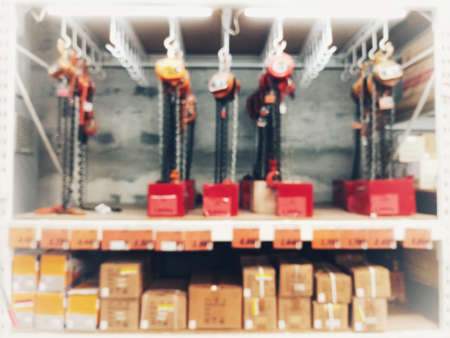 Blurred images of product shelves of mechanic equipment for background usage Stock fotó