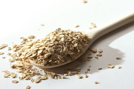 quaker: raw oatmeal in the wood spoon