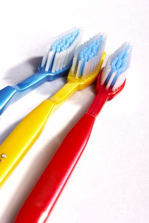 three  variegated tooth-brushes
