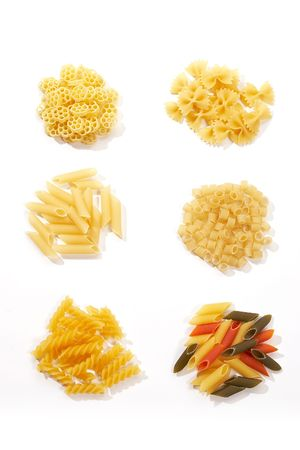 foodstuff: foodstuff: assorted kind of macaroni over white Stock Photo