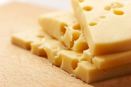 macro pic of Edam cheese on the wooden board Stock Photo