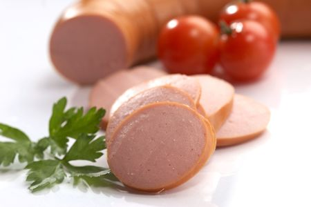 boiled sausage: cut boiled sausage with parsley and tomato