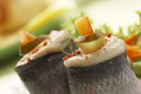 macro picture of fillet herring with vegetables