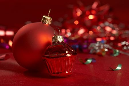 Christmas still life in the red color on the blurry garland background photo
