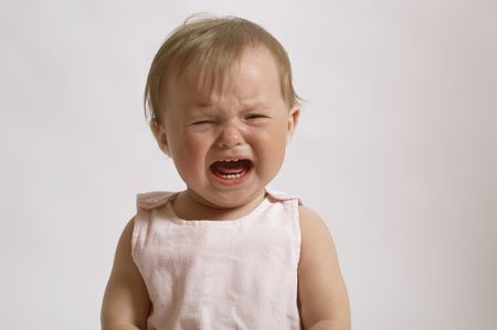portrait of crying baby. little girl in the bad mood and to burst into tears Stock Photo