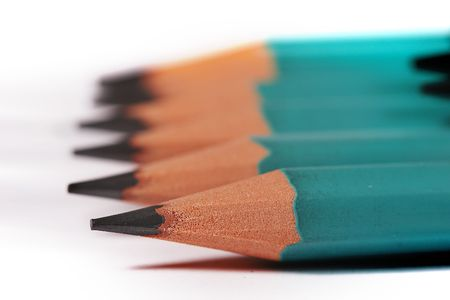 chancellery: macro picture: a row of cloistered pencils