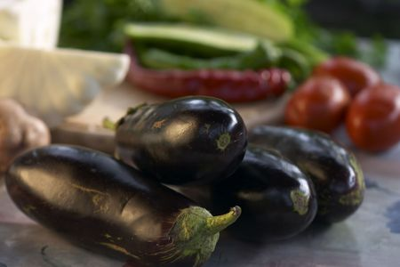cymbling: close up view of aubergine on the veggies background Stock Photo