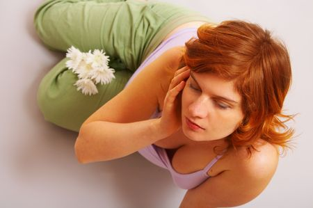 portrait of pregnant woman with flower top view, meditation Stock Photo