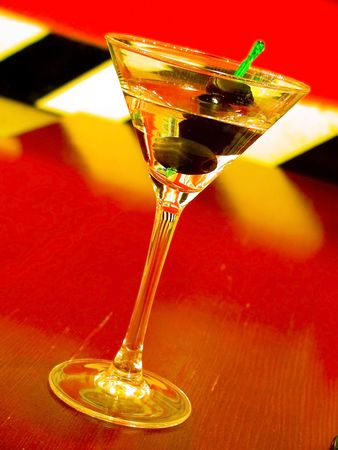 alcohol cocktail with olives in the special glass under neon lights Stock Photo