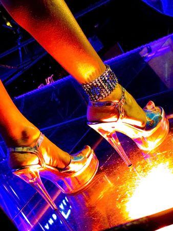 pretty woman legs on the glassy night club floor