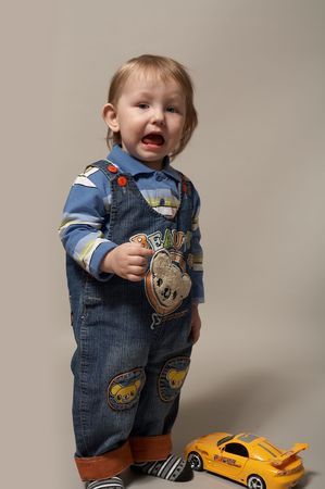 deplorable: portrait of crying little boy in a jeans