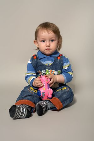 deplorable: portrait of sorrowful  little boy with toy