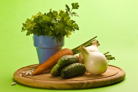 vegeterian: vegeterian food, fresh vegetables: onion, carrot, cucumber and parsley Stock Photo