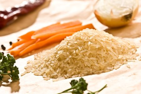 hill of raw rice with vegetables and parsley photo