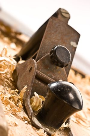 timbering: Old plane on wooden table with shavings Stock Photo