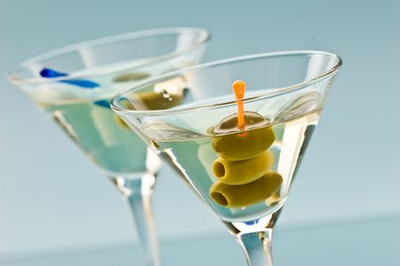 bocal: one bocal of martini with olive over blue