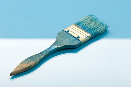 designe: blue paint brush on the blue background