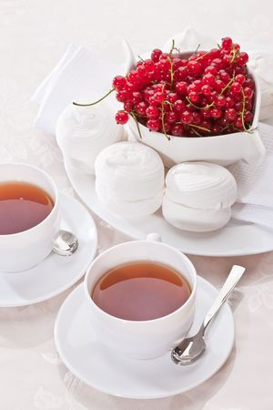 drink series: cup of tea with sweets and currants photo