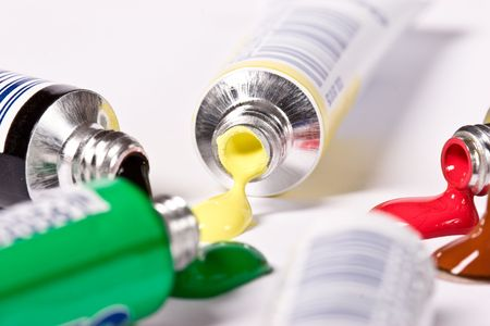 Open tube of blue , red, green  and yellow paint Stock Photo - 5886963