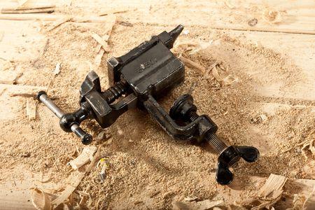 vice grip: tools series: steel black grip vice on sawdust table Stock Photo