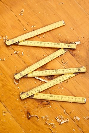 wooden metre: tools series: carpenter ruler on the wooden plank