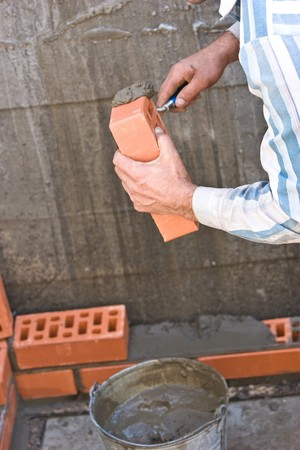 wall under bricklaying with brick and cement Stock Photo - 6909234