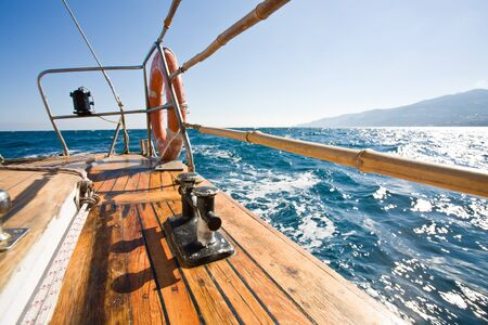 summer series: modern wooden yacht in the sea. Deck view