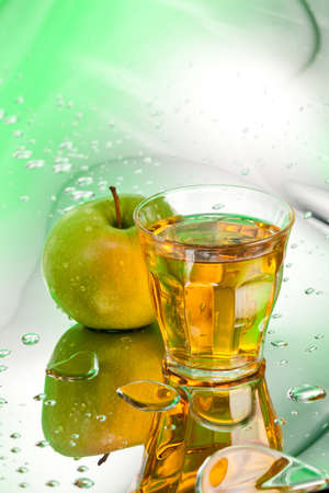ripe apple and juice on abstract background Stock Photo - 12718451