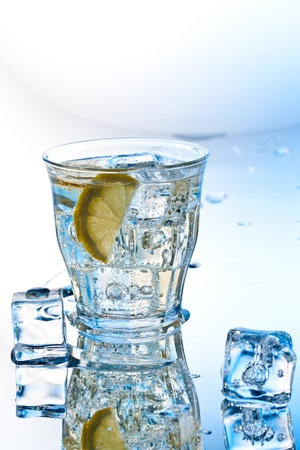 cold soda drink with ice and lemon photo