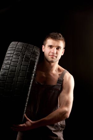 repairman with big wheel over black background Stock Photo - 13214473