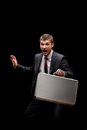 businessman with steel case over black photo
