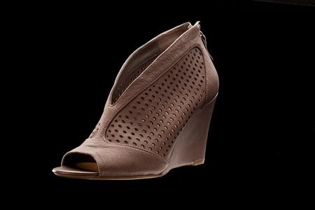heel strap: new leather sandals over black background