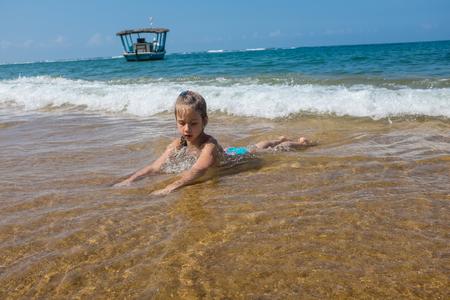 Little girl at ocean beach, Beruwala, Sri Lanka Stock Photo