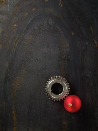 stell: Gear and red Christmas ball on the stell plate