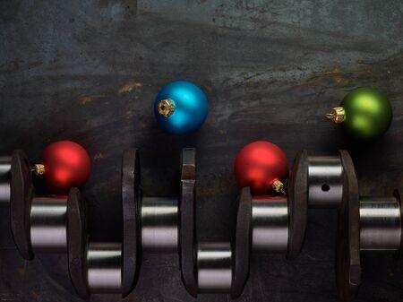 crankshaft: Shiny christmas bulb and crankshaft on the steel table