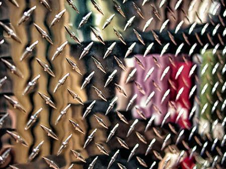 Reflection of bookshself in metal