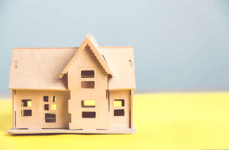 wooden house model on the table