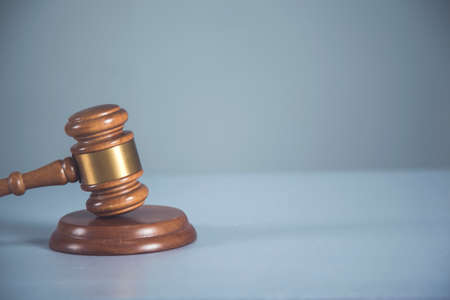 brown wooden judge on the desk